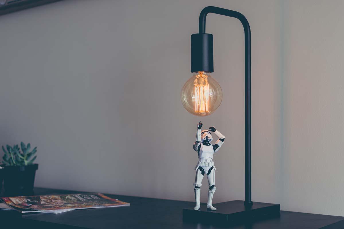 miniature stormtrooper looking at lamp